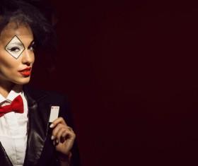 Clown makeup play poker woman Stock Photo 04