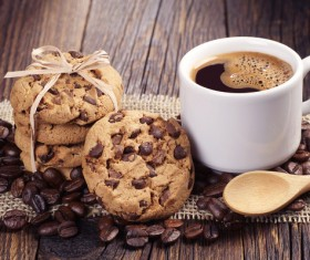 Coffee with chocolate chip cookie and coffee beans Stock Photo