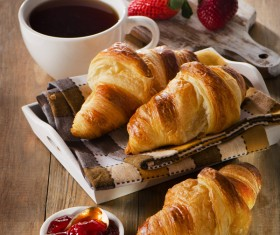 Coffee with croissant and strawberry jam Stock Photo