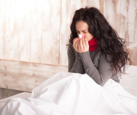 Colds Woman resting in bed Stock Photo