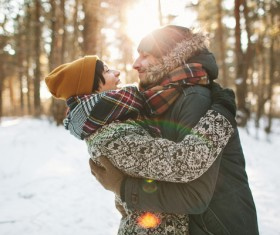 Couple hugging on the snow Stock Photo