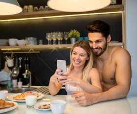 Couple using smart phone selfie at the table Stock Photo