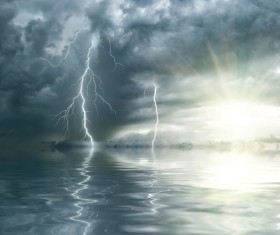 Dark clouds and lightning at sea Stock Photo