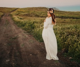 Elegant woman takes pictures on dirt roads Stock Photo
