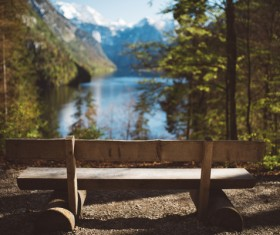 Empty wooden bench on tranquil lake landscape Stock Photo