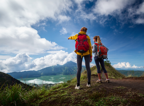 Hiking woman admiring the natural scenery Stock Photo
