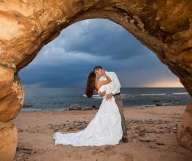 Honeymoon couple on the beach Stock Photo 02