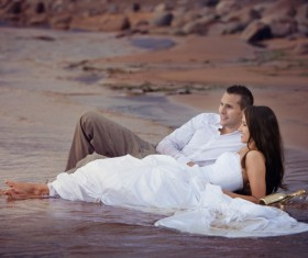 Honeymoon couple on the beach Stock Photo 03