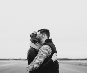Hugging couple black and white photo Stock Photo