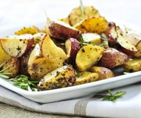 Italian herbs roasted potatoes Stock Photo 01