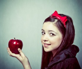 Little girl holding red apple Stock Photo