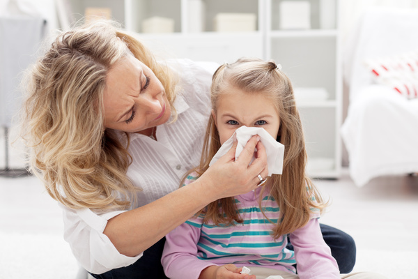 Little girl suffering from cold Stock Photo