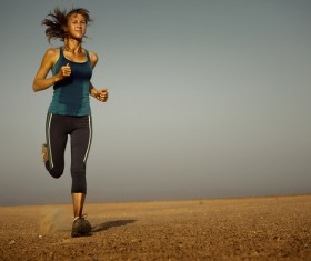 Long-distance running woman Stock Photo