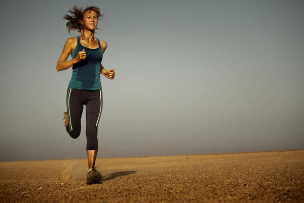 Long distance running woman Stock Photo