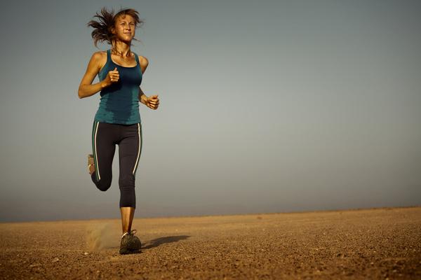 Long distance running woman Stock Photo