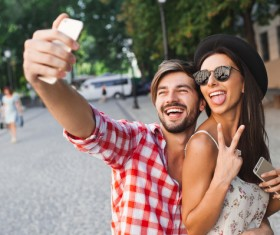 Lovers using smart phone selfie funny face Stock Photo