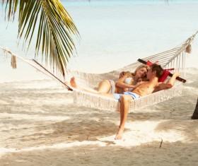 Loving couple on the beach hammock Stock Photo