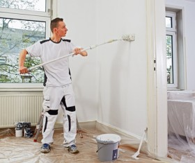 Man brushing the wall Stock Photo