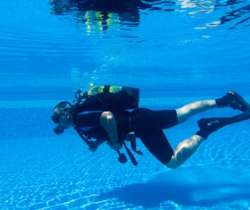 Man practicing diving in the swimming pool Stock Photo 01