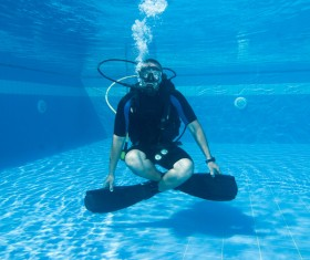 Man practicing diving in the swimming pool Stock Photo 02