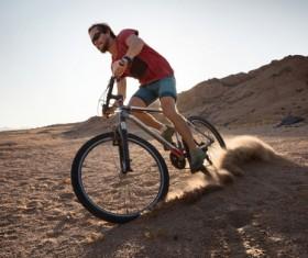 Man riding mountain bike Stock Photo