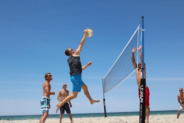Men's Beach Volleyball Game Stock Photo