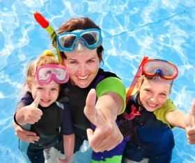 Mother diving with her daughter Stock Photo