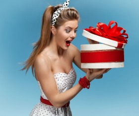 Open gift box surprised woman Stock Photo