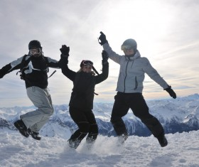 People jumping happily on the snow Stock Photo