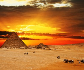 People traveling by camel to visit pyramids Stock Photo