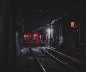 Railway station in dark tunnel Stock Photo