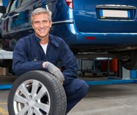 Repair car tires maintenance workers Stock Photo 01
