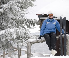 Rest skier sitting on the fence Stock Photo