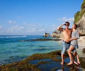 Romantic lovers walking on the beach Stock Photo 02