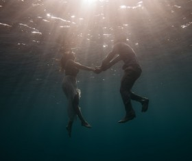 Romantic couple in the water Stock Photo