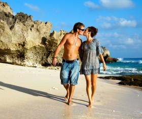Romantic lovers walking on the beach Stock Photo 01