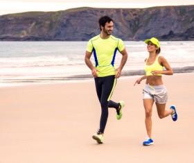 Running Lovers on the beach Stock Photo