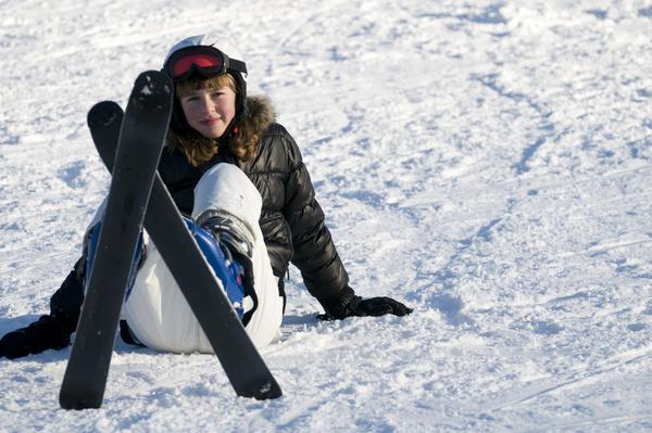 Ski girl resting on the snowy road Stock Photo