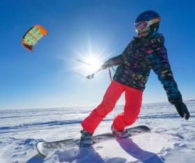 Skier pulling speed umbrella Stock Photo