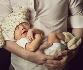 Sleeping baby in his arms Stock Photo
