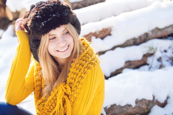 Smiling woman wearing fur hat Stock Photo
