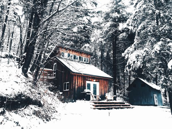 Snow covered cottage Stock Photo