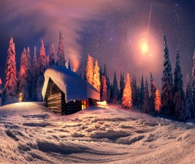 Snow-covered cottage in the forest Stock Photo