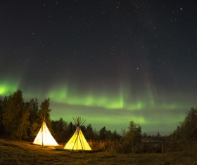 Sparkling bright sky above tents Stock Photo