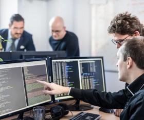 Staff compiled code analysis Stock Photo