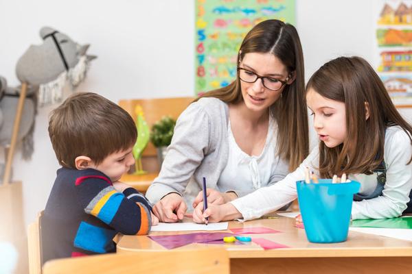 Teaching preschool children literacy Stock Photo