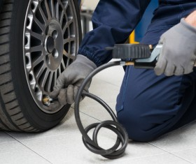 To inflate car tires Stock Photo