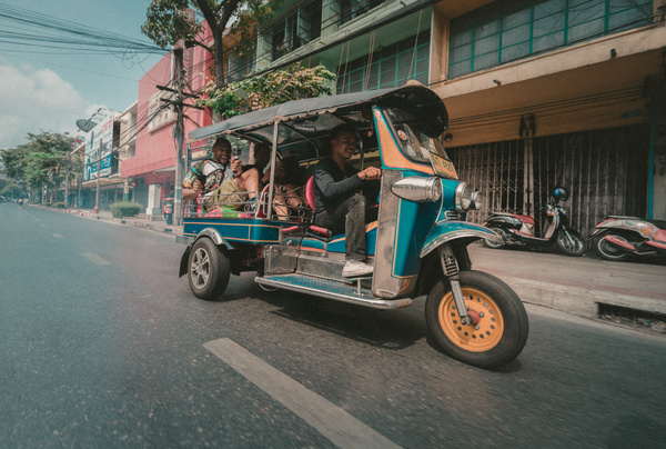 Traditional three wheeled taxi in town Stock Photo
