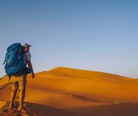 Traveler walking in the desert Stock Photo