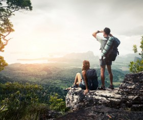 Watch the sunrise backpack Lover Stock Photo